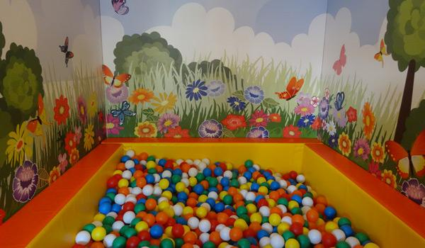 Softplay room with ball pool and wall decoration