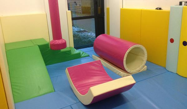 Softplay room with rainbow panels
